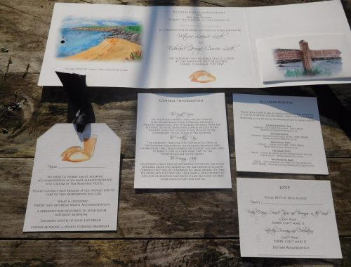 Seaside themed wedding stationery