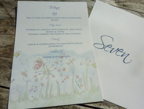 Spring Meadow designed menus on the back of table name cards